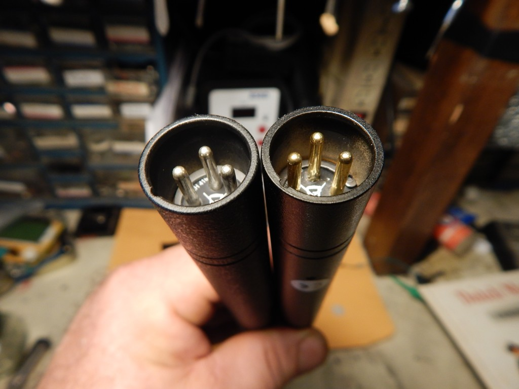 Real 416 (L) and fake (R). Notice paint underspray inside XLR, and silver vs gold pins.